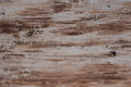 Flaking paint distressed wood with scraped and and weathered surface background or texture muted colours Royalty Free Stock Photos