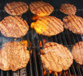 Flame Broiled Hamburgers Royalty Free Stock Photography