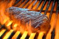 Flame broiled steak on a grill open Royalty Free Stock Photography