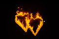 Flame-burning silhouettes of the heart. Royalty Free Stock Photo