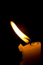 Flame of a candle on black background Royalty Free Stock Photo