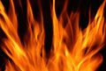 FLAME ON DARK BACKGROUND Royalty Free Stock Photo