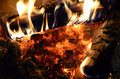 Flame and ember background beech birch firewood burning over decaying coals in a fireplace Stock Photo