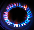 Flame gas stove in the dark. Royalty Free Stock Photo