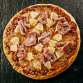 Flame grilled speciality Hawaiian Italian pizza Royalty Free Stock Photo