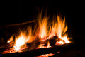 Flame of hot fire in dark Royalty Free Stock Photo