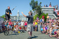 Flame throwers entertain crowds with one on a unicycle the crowd at the inner harbour celebrating canada day Royalty Free Stock Image