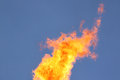Flame view on over blue sky Royalty Free Stock Photography