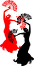 Flamenco dancer with red and black fans silhouette of two Royalty Free Stock Photos