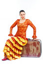 Flamenco dancer sitting on old suitcase Royalty Free Stock Photos