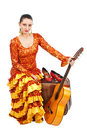 Flamenco dancer on suitcase with a guitar Royalty Free Stock Photo