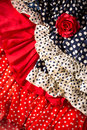 Flamenco dresses in red blue with spot and red rose typical from spain espana Royalty Free Stock Photography