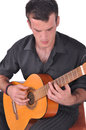 Flamenco guitar player young musician with style keeps his in his hands on a white background studio shot Stock Images