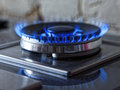 Flames of blue gas. Close up burning fire ring from a kitchen gas stove. Tinted photo Royalty Free Stock Photo
