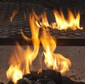 Flames on charcoal barbecue Royalty Free Stock Photography