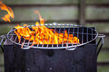 Flames fire of the bbq outdoors and grilling board Stock Image