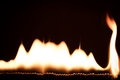 Flames and fire in front of black, lots of matches burning Royalty Free Stock Photo