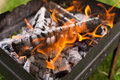 Flames in the grill and coals Royalty Free Stock Images