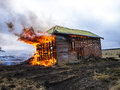 Flames from house on fire and smoke in burning Royalty Free Stock Photo