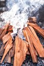 Flames and smoke from burning wood Royalty Free Stock Photo