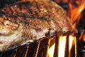 Flaming barbecue ribs on a grill Royalty Free Stock Photo