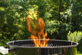 Flaming Barbeque Charcoal Grill Stock Image
