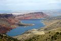 Flaming gorge blue lake contrasted with red cliffs some greenery one of many examples of the in utah Stock Images
