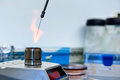 Flaming inoculating loop microbiological using gas burner in laboratory Royalty Free Stock Image
