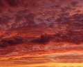 Flaming red orange sky at the evening twilight, orange sunset, colourful sunset, eartistic photo of evening twilight Royalty Free Stock Photo