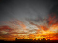 Flaming sunset ominous glowing over a dark landscape Royalty Free Stock Image