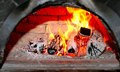 Flaming wood in old brick fireplace Royalty Free Stock Photo
