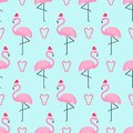 Flamingo in xmas hat with candy cane heart seamless pattern. Royalty Free Stock Photo