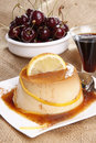 Flan and cherries Royalty Free Stock Photography
