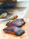 Flank steak grilled freshly on cutting board Royalty Free Stock Images