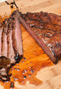 Flank steak sliced juicy slicked on cutting board Stock Photo