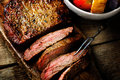 Flank steak with tomato salad and glass of beer style vintage selective focus top view Stock Images