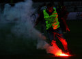 Flare on football pitch a steward takes a off the during derby game between dinamo bucharest and steaua bucharest held national Stock Images