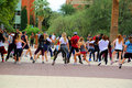Flash mob college students dancing in a public area Royalty Free Stock Images