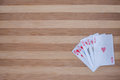 Flash royal heart on the table cards wooden gambling with cards Stock Image