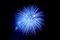 Flashes of blue fireworks and blue smoke against the black sky Royalty Free Stock Photo