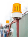 Flashing beacon orange in the place of work Royalty Free Stock Photos