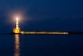 Flashing lighthouse by night old sea port in chania city greece crete Stock Image