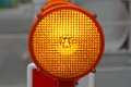 Flashing lights beacon for road works safety Stock Photos