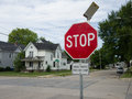 Flashing stop sign solar powered led with a on the bottom saying cross traffic does not Royalty Free Stock Image