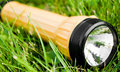 Flashlight in grass Royalty Free Stock Photo