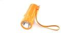 Flashlight orange laying on white background Royalty Free Stock Photos