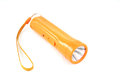 Flashlight orange laying on white background Stock Photo
