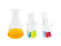 Flask and test tubes with solution in small beaker Royalty Free Stock Photo