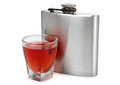 Flask and whiskey flat metal glass on white background Royalty Free Stock Photos