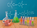 Flasks chemistry and board with chemical formulas Stock Photography